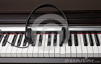 Ear-phones lie on the piano