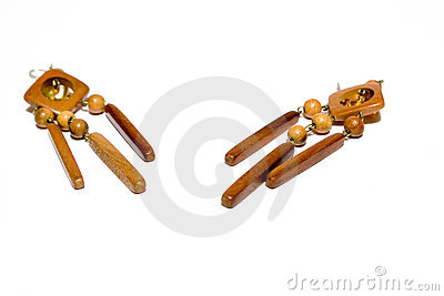 Ear-ring from wood isolated background