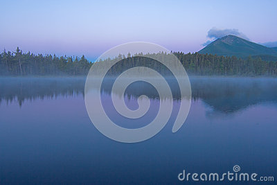 Early dawn landscape with mountain and pond