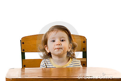 Early education baby boy sitting at school desk