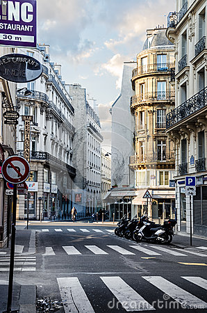 Early morning, first rays of the sun touch the streets of Paris Editorial Stock Photo