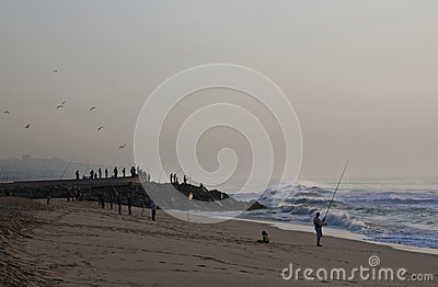 Early Morning Fishermen on Durban s Blue Lagoon Beach Editorial Photo