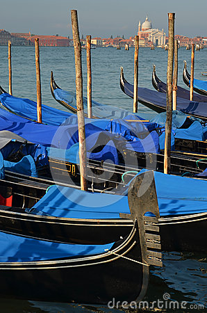 Early morning in gondolas harbor, Venice