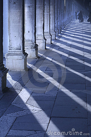 Early morning light casts long shadows in San Marco Piazza, Veni