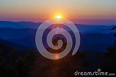 Early morning sunrise over blue ridge mountains
