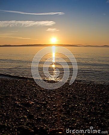 Early morning sunrise at serene beach