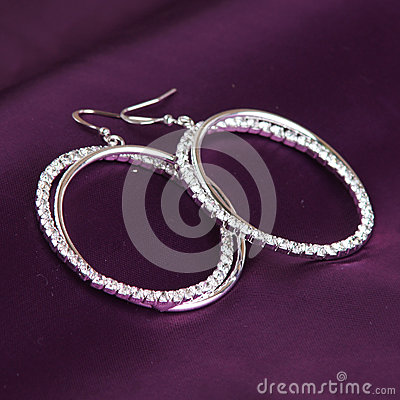 Earrings on purple background