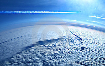 Earth from above the clouds and plane