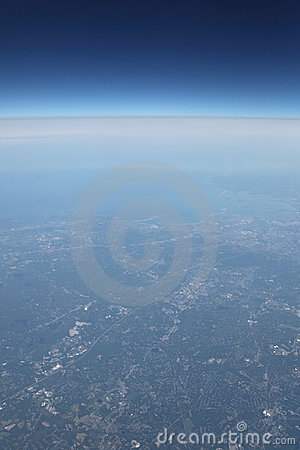 Earth coastline and deep sky space from airplane