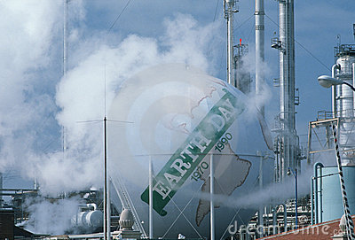Earth Day sign at oil refinery Editorial Stock Image