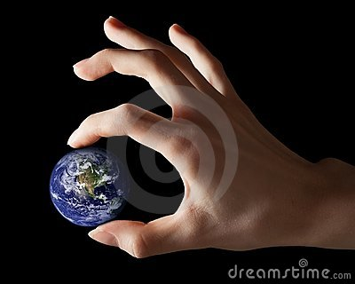 Earth between fingers