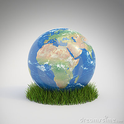 Earth globe growing in a patch
