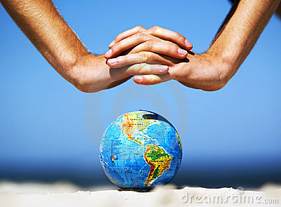 Earth globe with hands over it. Conceptual image