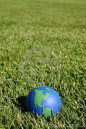 Earth globe showing USA in green grass