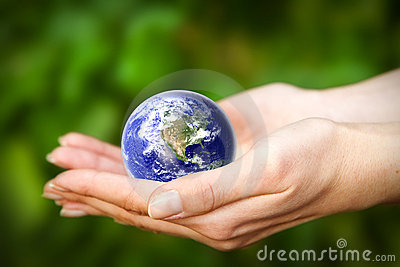 Earth in hands. Glass World