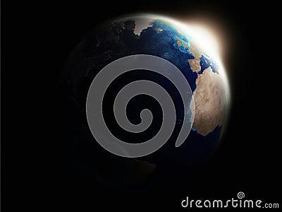 Earth illuminated by rising sun rays
