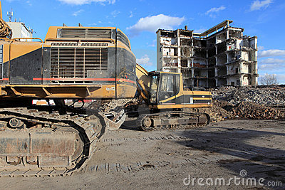 Earth mover and industrial ruins
