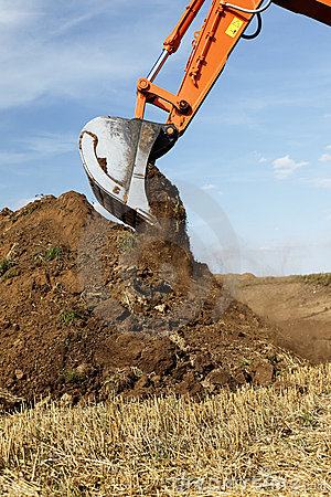 Earth mover scooping dirt