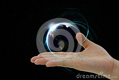 The Earth planet hovering over the hand