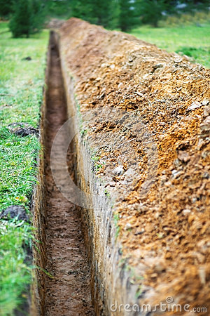 Earthen trench