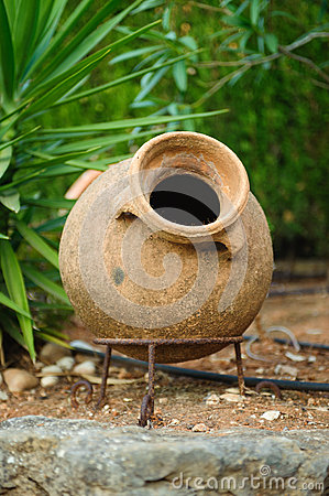 Earthenware jar in garden