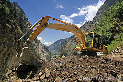 Earthmover bulldozer in himalayas clearing landslide