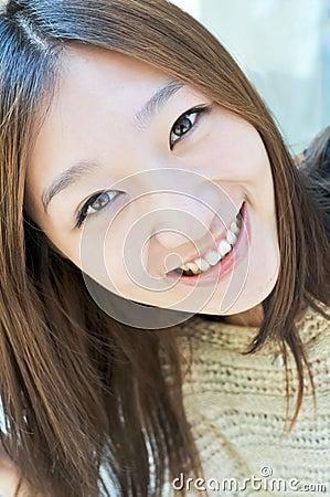 East asian girl smiling face