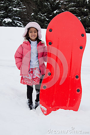 Free East Indian Girl Toboganning In The Snow Stock Images - 28671954
