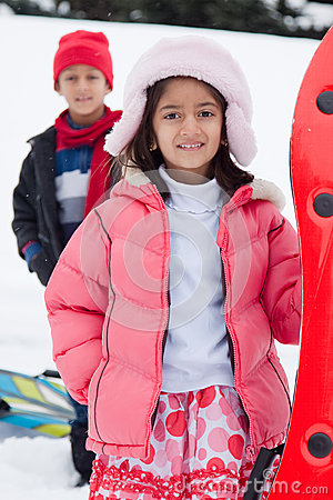 Free East Indian Kids Toboganning In The Snow Royalty Free Stock Image - 28671946