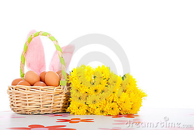 Easter basket with eggs, flowers and bunny ears