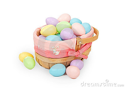 Easter basket with pastel colored plastic eggs