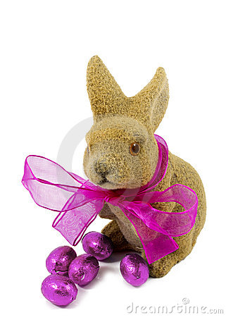Easter bunnie with pink bow and Easter eggs.