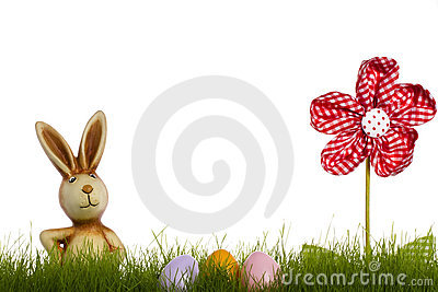Easter bunny behind grass with drapery flower and