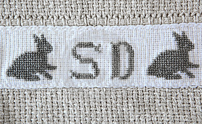 Easter bunny Cross-stitch on cotton blanket.