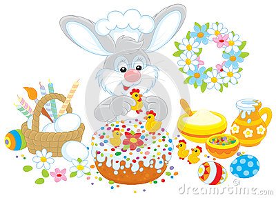 Easter bunny decorates a cake
