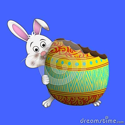 Easter bunny eating Easter egg Stock Photo