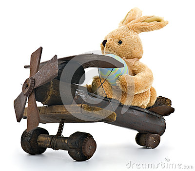 Easter Bunny Delivering Egg in Antique Toy Airplane- Isolated