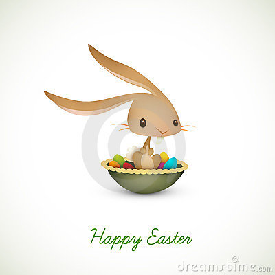 Easter Bunny Sitting in Bowl full of Colored Eggs