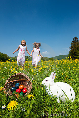 Easter Bunny Watching The Egg Hunt Royalty Free Stock Photo - Image: 12739845