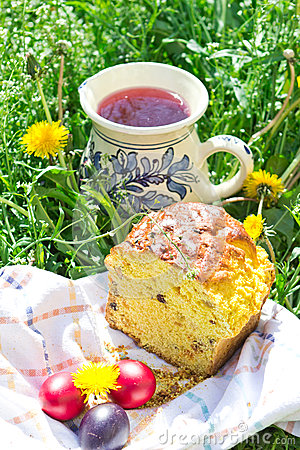 Easter cake, eggs and jug with compote Stock Photo
