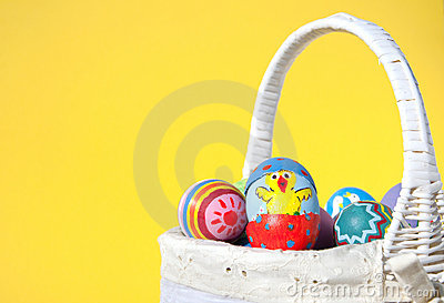 Easter chick painted on an egg shell peeking out
