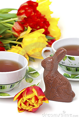 Easter chocolate bunny, tulips and tea