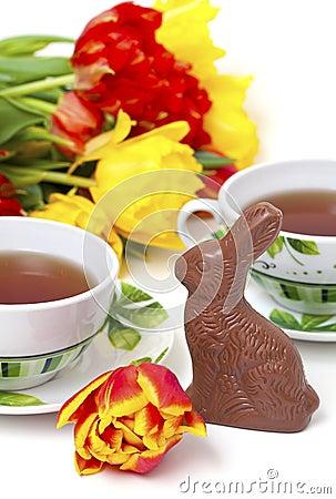 Easter chocolate bunny, tulips and tea