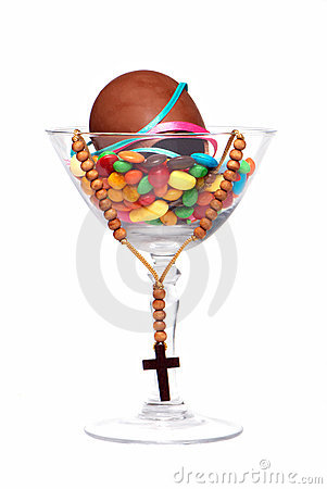Easter chocolate egg , sweets and cross in a glass