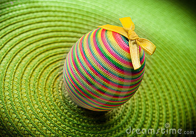 Easter decorastion egg  on green background