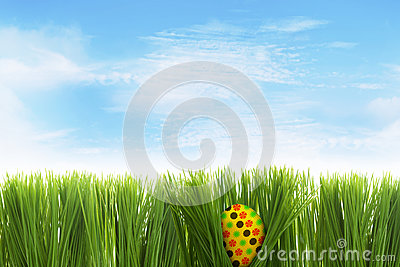 Easter egg behind grass
