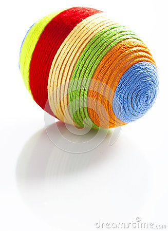 Easter egg with colorful woolen yarn