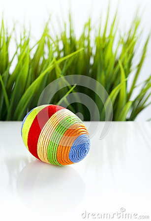 Easter egg covered with colorful woolen yarn