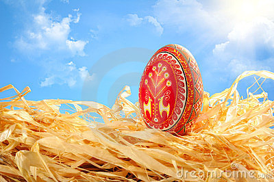 Easter egg painted on sky background