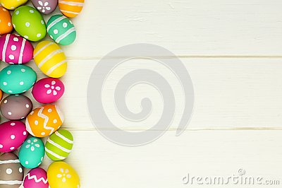 Easter egg side border against white wood Stock Photo
